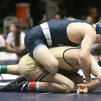 February 23, 2014; State College, PA, USA;  Penn State's Zain Retherford tries to gain wrist control against Clarion's Tyler Bedelyon in their 141-pound match at Rec Hall.  Retherford scored an 8-4 decision win and Penn State defeated Clarion 43-3.