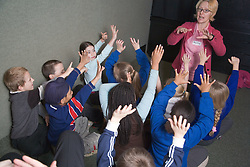 Excited primary school children inside a mobile classroom during a life skills lesson,