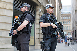 © Licensed to London News Pictures . 25/05/2017 . Manchester , UK . Armed police in St Ann's Square in Manchester City Centre after a minute's silence is held in St Ann's Square in Manchester City Centre , following a terrorist attack at an Ariana Grande concert at Manchester Arena that killed twenty two people . Photo credit: Joel Goodman/LNP