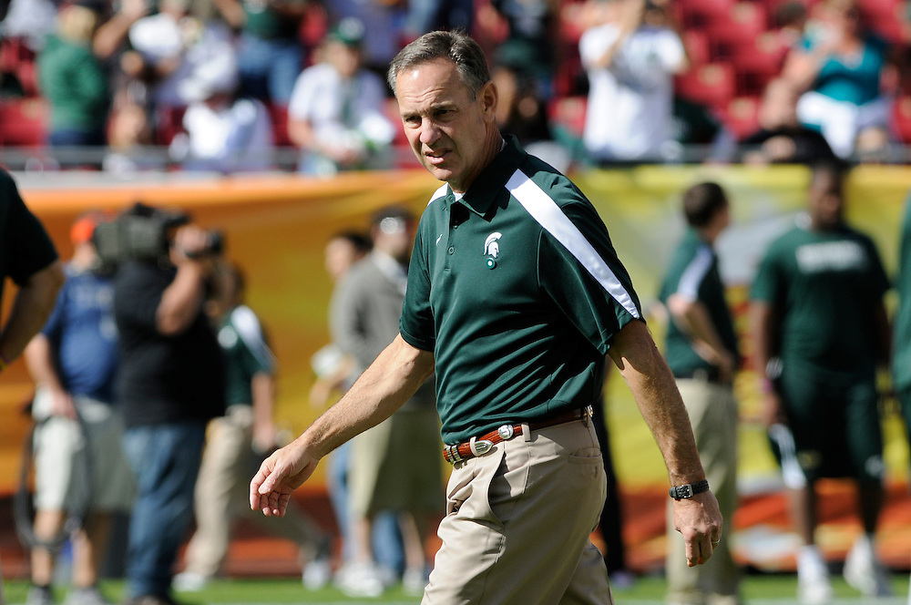 January 2, 2012: Head coach Mark Dantonio of Michigan State watches his team warm up before the NCAA football game between the Michigan State Spartans and the Georgia Bulldogs at the 2012 Outback Bowl at Raymond James Stadium in Tampa, Florida.