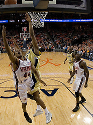 Virginia Cavaliers point guard Sean Singletary (44) shoots a lay-up over Georgia Tech Yellow Jackets Guard Anthony Morrow (23).  The Virginia Cavaliers Men's Basketball Team defeated the Georgia Tech Yellow Jackets 75-69 at the John Paul Jones Arena in Charlottesville, VA on February 24, 2007.