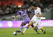 Gulselam Ceylun (R) and Moussa Sissoko battle for the ball. Toulouse v Trabzonspor, Europa Cup, Second Leg, Stade Municipal, Toulouse, France, 27th August 2009.