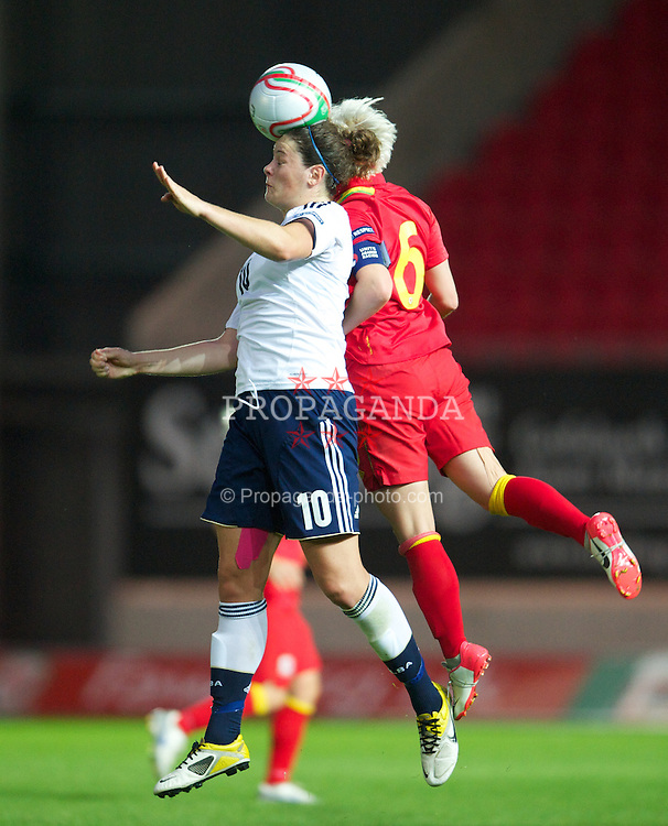 LLANELLI, WALES - Saturday, September 15, 2012: Wales' captain Jessica Fishlock in action against Scotland's Jennifer Beattie during the UEFA Women's Euro 2013 Qualifying Group 4 match at Parc y Scarlets. (Pic by David Rawcliffe/Propaganda)