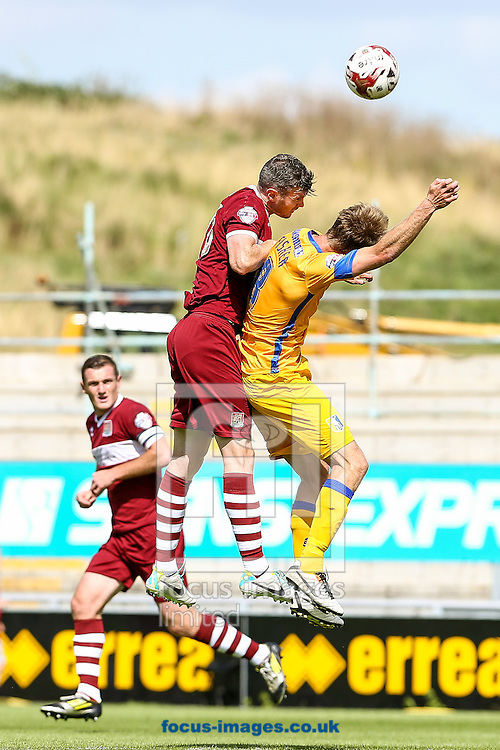 Zander Diamond of Northampton Town (left)  gets up to head the ball during the Sky Bet League 2 match at Sixfields Stadium, Northampton<br /> Picture by Andy Kearns/Focus Images Ltd 0781 864 4264<br /> 09/08/2014