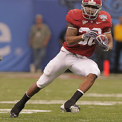 2 January 2009: Alabama running back Glen Coffee (38) runs with the ball during the 75th annual All State Sugar Bowl  between the Utah Utes and the Alabama Crimson Tide at the Louisiana Superdome in New Orleans, LA.