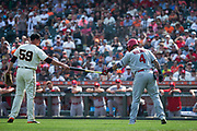 San Francisco Giants relief pitcher Kyle Crick (59) hands a bat to St. Louis Cardinals catcher Yadier Molina (4) after it slipped out of his hands during an at bat at AT&T Park in San Francisco, California, on September 3, 2017. (Stan Olszewski/Special to S.F. Examiner)