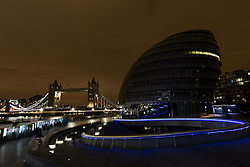 © Licensed to London News Pictures. 19/03/2016. London, UK. Tower Bridge and City Hall in London seen with the lights turned off during Earth Hour 2016. Landmarks around the world are switching their lights off for Earth Hour this evening, a global switch-off event aimed at protecting the planet and highlighting the effects of climate change. This year marks the 10th annual Earth Hour. Photo credit : Vickie Flores/LNP