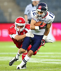 02.06.2014, UPC Arena, Graz, AUT, American Football Europameisterschaft 2014, Gruppe B, Daenemark (DEN) vs Frankreich (FRA), im Bild Mikkel  Vangsgard, (Team Denmark, LB, #8) und  Paul  Durand , (Team France, WR , #12) // during the American Football European Championship 2014 group B game between Denmark and France at the UPC Arena, Graz, Austria on 2014/06/02. EXPA Pictures © 2014, PhotoCredit: EXPA/ Thomas Haumer