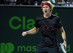 March 30, 2018 - Miami, Florida, United States - Alexander Zverev, from Germany, reacts after winning a point against Pablo Carreno Busta, from Spain, during his semi final match at the Miami Open in Key Biscayne. Zverev defeated Carreno Busta 7-6(4), 6-2 in Miami, on March 30, 2018. (Credit Image: © Manuel Mazzanti/NurPhoto via ZUMA Press)