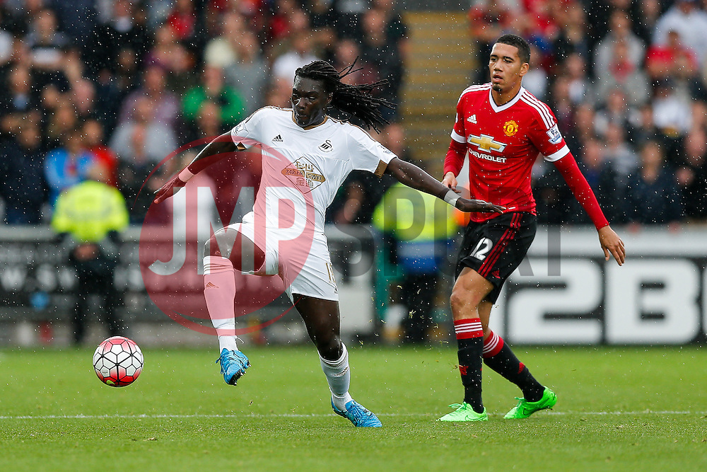 Bafetibis Gomis of Swansea City is challenged by Chris Smalling of Manchester United - Mandatory byline: Rogan Thomson/JMP - 07966 386802 - 30/08/2015 - FOOTBALL - Liberty Stadium - Swansea, Wales - Swansea City v Manchester United - Barclays Premier League.