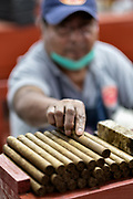 A cigar roller called a torcedor stacks completed fine cigars at the Santa Clara cigar factory in San Andres Tuxtlas, Veracruz, Mexico. The factory follows traditional hand rolling using the same process since 1967 and is considered by aficionados as some of the finest cigars in the world.