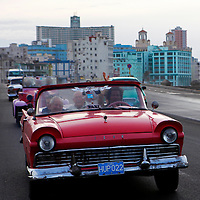 Central America, Cuba, Havana. Classic convertible on the Malecon.