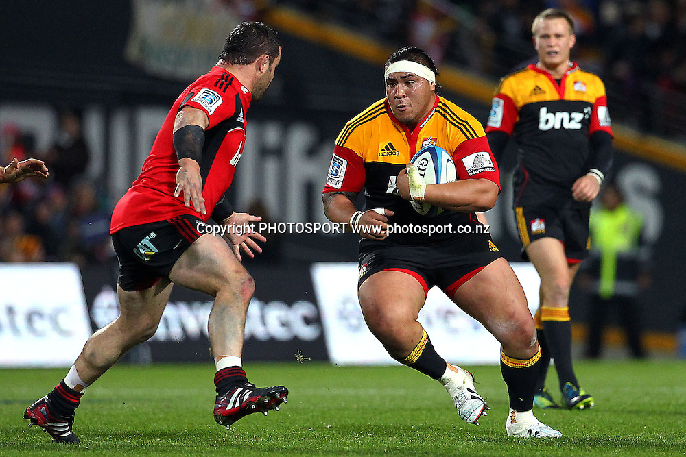 Chiefs' Ben Tameifuna runs at Crusaders' Corey Flynn. Super Rugby rugby union match, Chiefs v Crusaders at Waikato Stadium, Hamilton, New Zealand. Friday 6th July 2012. Photo: Anthony Au-Yeung / photosport.co.nz