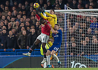 Football - 2017 / 2018 Premier League - Chelsea vs Manchester United<br /> <br /> Thibaut Courtois (Chelsea FC) comes off his line to collect above the head of Romelu Lukaku (Manchester United) <br /> at Stamford Bridge <br /> <br /> COLORSPORT/DANIEL BEARHAM