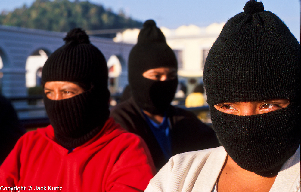 FEB 24, 2001 - SAN CRISTOBAL DE LAS CASAS, CHIAPAS, MEXICO: EZLN (Zapatista) gather on the Zocalo in San Cristobal de las Casas, Chiapas, Mexico, before a pro-Zapatista rally, Feb. 24, 2001. The rally was to mark the beginning of the Zapatista's march from San Cristobal de las Casas to Mexico City. The Zapatistas went to Mexico City to press their demands for the passage of the San Andres Accords, signed between the Zapatistas and the Mexican government in 1996 but stalled in the Mexican congress by the formerly ruling Institutional Revolutionary Party.  © Jack Kurtz    INDIGENOUS   WOMEN   CIVIL RIGHTS   POVERTY  HUMAN RIGHTS   GLOBALIZATION