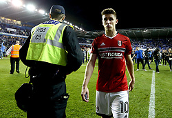 Tom Cairney of Fulham looks dejected as he walks past a police officer after his side's defeat to Reading in the Championship Playoff Semi-Final - Mandatory by-line: Robbie Stephenson/JMP - 16/05/2017 - FOOTBALL - Madejski Stadium - Reading, England - Reading v Fulham - Sky Bet Championship Play-off Semi-Final 2nd Leg