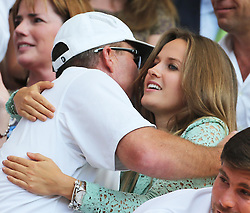 Kim Sears hugs coach Ivan Lendl after Andy Murray  wins  the Men's Final at the Wimbledon Tennis Championships in  London, Sunday, 7th July 2013<br /> Picture by Stephen Lock / i-Images