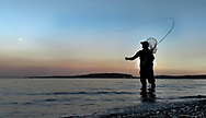 Dave Thomas fishes for Salmon from the beaches of the Puget Sound in Washington State.