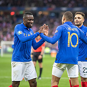PARIS, FRANCE - March 25: Kylian Mbappé #10 of France is congratulated by team mates Blaise Matuidi #14 of France and Layvin Kurzawa #22 of France after scoring his sides third goal during the France V Iceland, 2020 European Championship Qualifying, Group Stage at Stade de France on March 25th 2019 in Paris, France (Photo by Tim Clayton/Corbis via Getty Images)