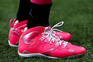 Detroit Lions wide receiver Golden Tate (15) wears pink cleats during warm ups prior to an NFL football game against the Arizona Cardinals at Ford Field in Detroit, Sunday, Oct. 11, 2015. (AP Photo/Rick Osentoski)