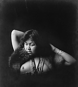 Native woman, nude, half-length portrait, facing slightly left.