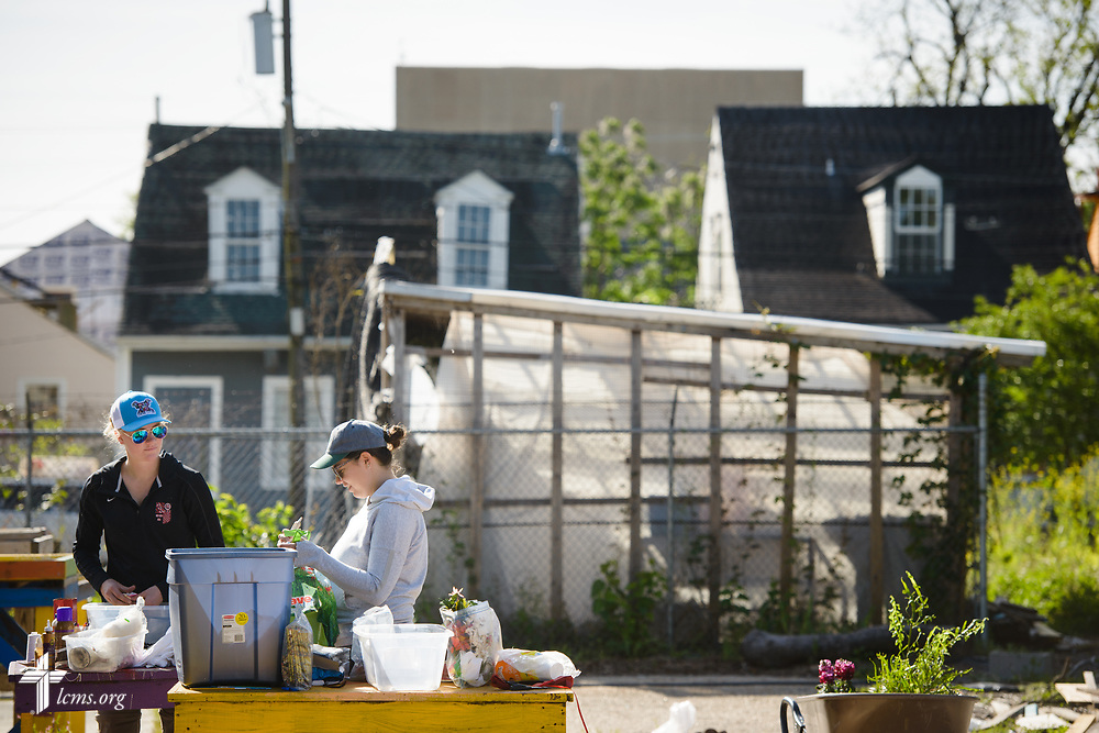 Young Adult Corps participants Courtney Haag (left), and Madison Ezzell, work at Gloria Ward's community garden on Thursday, April 5, 2018, in New Orleans. LCMS Communications/Erik M. Lunsford
