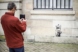 A mural showing a rat holding a placard reading RIC, the acronym for (Citizen's Initiated Referendum) and inspired by the graffiti artist Banksy.on February 19, 2019 in Bordeaux, France. Photo by Thibaud Moritz/ABACAPRESS.COM