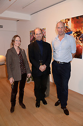 Left to right, PAULA FLETCHER, PIERS FLETCHER Producer of QI and ED PARKER founder of Walking With The Wounded at a reception to launch Prestat's special edition of their award-winning chocolate bars to raise money for the charity Walking with the Wounded held at Sladmore Gallery, Bruton Place, London on 10th October 2013.