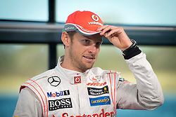 © London News Pictures. 31/01/2013 . Woking, UK.  Team McLaren Mercedes driver Jenson Button at the unveil the new MP4-28 Formula 1 car at the McLaren Technology Centre in Woking, Surrey, UK on  Thursday, Jan. 31, 2013. Photo credit : Ben Cawthra/LNP