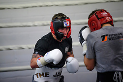 © London News Pictures. 29/12/2016. Two-weight world boxing champion, Carl Frampton (centre), nickname The Jackal, sparring at his gym in south London. Frampton has been named ESPN's fighter of the year. Photo credit: Ben Cawthra/LNP