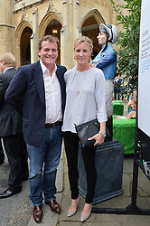 Trainer RICHARD HANNON and his wife JEMIMA at the launch of Chelsea Thoroughbreds held at St.Luke's Church, Sydney Street, London on 2nd July 2014.
