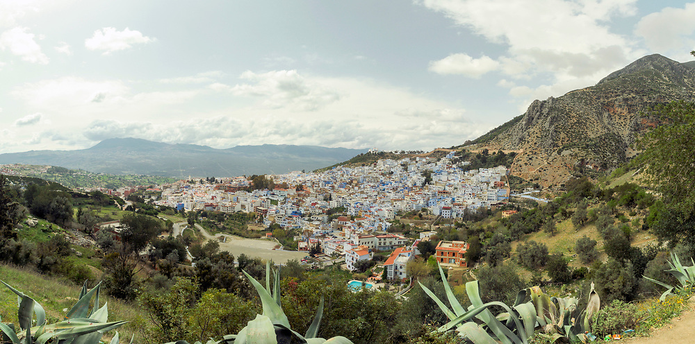 View of the Chefchaouen Medina - the blue city- amid Rif Mountain landscape setting, Rif region of Northern Morocco, 2014-03-28.