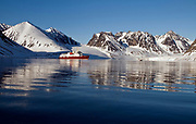 "Magdalenefjord at 79 degrees N in north-western Spitsbergen, Svalbard.  the expedition vessle ""Polar Star"" is anchored here this early morning in June."
