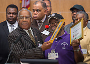 Houston Ministers Against Crime president Pastor F.N. Williams, Sr., left, recognizes the volunteer efforts of Pastor Eugene Jones, right, during a press conference for Project Safe Start, a collaborative program between area ministers, law enforcement and school officials to encourage students to have a safe summer, May 27, 2014.