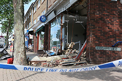 © under license to London News Pictures. 06/08/12. Hassocks, West Sussex. Thieves attempted to steal cash in a ram raid using a digger at  Barclays Bank in Keymer Road in Hassocks on August 6, 2012. Residence reported a large digger abandoned at the scene.Xavier Itter/LNP