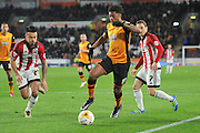 Hull City striker Chuba Akpom (19) under attack from Nico Yennaris (28) of Brentford and Sam Saunders (7) of Brentford during the Sky Bet Championship match between Hull City and Brentford at the KC Stadium, Kingston upon Hull, England on 26 April 2016. Photo by Ian Lyall.