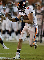 Virginia tight end John M. Phillips (85) after a pass reception.  The #19 Virginia Cavaliers defeated the Miami Hurricanes 48-0 at the Orange Bowl in Miami, Florida on November 10, 2007.  The game was the final game played in the Orange Bowl.