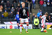 """Milton Keynes Dons defender Dean Lewington (3) warms up in a """"Men United"""" Prostate Cancer T-Shirt during the EFL Sky Bet League 1 match between Milton Keynes Dons and Portsmouth at stadium:mk, Milton Keynes, England on 10 February 2018. Picture by Dennis Goodwin."""