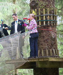 Martin Milner and Colette Gregory tying the knot in the trees at Go Ape Aberfoyle. Registrar Carolyn Goss in the trees.