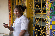 Sandy checking her business support text messages on her mobile phone.<br /> <br /> Diopse Sandy runs a sign painting business called 'Statement Art Gallery'.<br /> <br /> The main thing she has got from the business up port text message service is around treating her staff better and the broader motivational impact of the messages, encouraging her to carry on. <br /> <br /> She is the only woman running this type of business in the area.