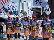 09 JUNE 2018 - SEOUL, SOUTH KOREA: Men at a pro-American rally in downtown Seoul. Participants said they wanted to thank the US for supporting South Korea and they hope the US will continue to support South Korea. Many were also opposed to ongoing negotiations with North Korea because they don't think Kim Jong-un can be trusted to denuclearize or to not attack South Korea.    PHOTO BY JACK KURTZ
