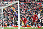 \l1\ tips the ball over the bar as Liverpool forward Mohamed Salah (11) and Tottenham Hotspur defender Toby Alderweireld (4) look on during the Premier League match between Liverpool and Tottenham Hotspur at Anfield, Liverpool, England on 31 March 2019.