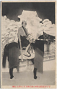 Actor Morita Kanya atop two men dressed in a horse costume, from the play Suruga Dainagon Saigo, role name Batei Jirokichi, Imperial Theater, Tokyo, May 1917, collotype post card.<br />