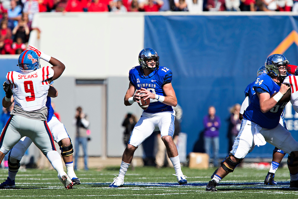 MEMPHIS, TN - OCTOBER 17:  Paxton Lynch #12 of the Memphis Tigers drops back to pass during a game against the Ole Miss Rebels at Liberty Bowl Memorial Stadium on October 17, 2015 in Memphis, Tennessee.  The Tigers defeated the Rebels 37-24.  (Photo by Wesley Hitt/Getty Images) *** Local Caption *** Paxton Lynch