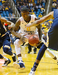 Nov 11, 2016; Morgantown, WV, USA; West Virginia Mountaineers guard Teyvon Myers (0) drives down the lane during the second half against the Mount St. Mary's Mountaineers at WVU Coliseum. Mandatory Credit: Ben Queen-USA TODAY Sports