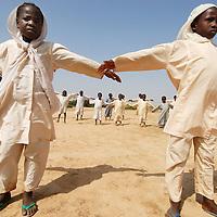 Darfur, Sudan.September 2007 <br /> Dar El Salam School , Krindig 2 camp<br /> Gym class<br /> Firdous Abdul Azeez left<br />  Ishraga Abdul Rahmin -right