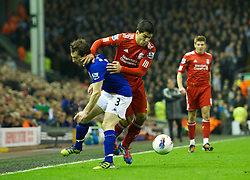 LIVERPOOL, ENGLAND - Tuesday, March 13, 2012: Liverpool's Luis Alberto Suarez Diaz in action against Everton's Leighton Baines during the Premiership match at Anfield. (Pic by David Rawcliffe/Propaganda)
