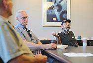 Roger Wiest (from left), of Cedar Rapids, and Richard Hrvol, of Cedar Rapids, listens as Jay Kaiser, of Cedar Rapids, talks about the proposed veterans center at Wells Fargo Bank in Cedar Rapids on Tuesday, July 16, 2013.
