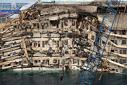 60490192<br /> Isola del Giglio, Italy. <br /> A view of the wreck of Italy's Costa Concordia cruise ship after it emerged from the water on September 17, 2013, near the harbour of Giglio Porto. On 13 January 2012, she was wrecked off the coast of Isola del Giglio in Italy. She has been declared a total loss and is being salvaged as of 2013, following which she will be scrapped, Italy, Tuesday September 17, 2013,<br /> Picture by imago / i-Images<br /> UK ONLY