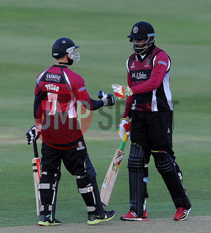 Somerset's Peter Trego and Chris Gayle - Photo mandatory by-line: Harry Trump/JMP - Mobile: 07966 386802 - 05/06/15 - SPORT - CRICKET - Somerset v Hampshire - The County Ground, Taunton, England.